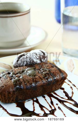close up of chocolate cake and coffee