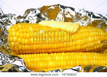 freshly baked corn on the cobb with melting butter