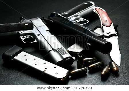 pistol and knife, low key
