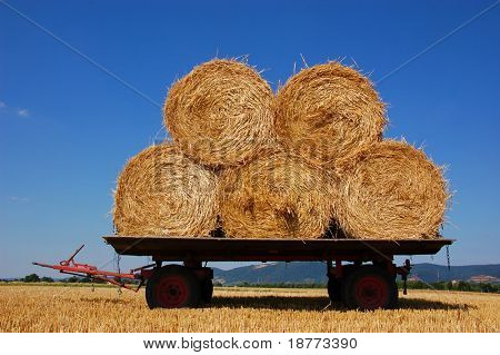 Balls of hay on an agriculture trailer