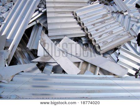 Aluminum scrap metal sheets on a recycling area