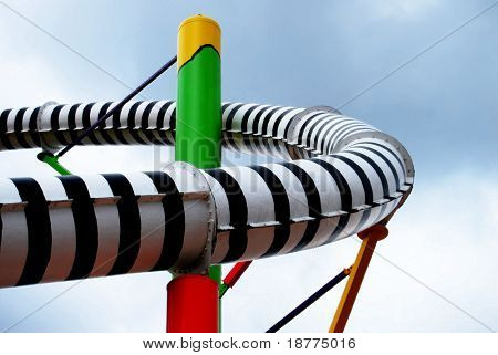 zebra striped pipe of a waterslide in a swimming pool