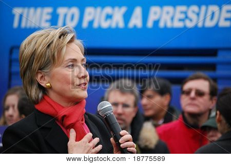 "MANCHESTER, NH – JAN 8: Senator Hillary Clinton  with text ""time to pick a president"" campaigning to become the Democratic presidential candidate on January 8, 2008, in Manchester, New Hampshire."