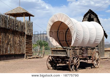 Fortress with lookout tower and wagon in the old West