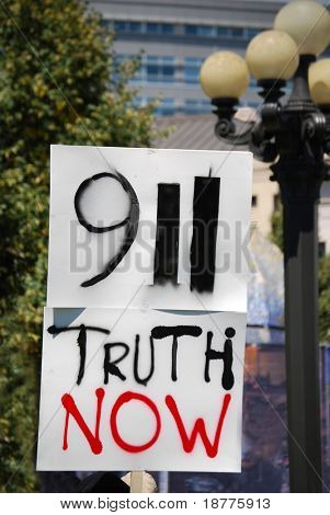 "DENVER – AUGUST 26: A conspiracy theory supporter (not shown) from ""9-11 Truth Now"" holds a sign at a demonstration during the Democratic Convention on August 26, 2008 in Denver, Colorado."