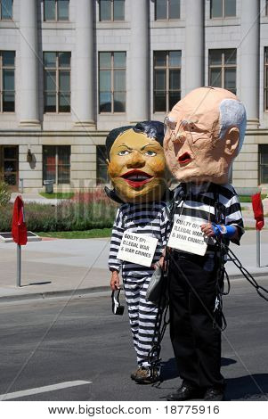 DENVER – AUGUST 26: Demonstrators posing as Secretary of State Condoleezza Rice and Vice President Dick Cheney walk along a street during the Democratic National Convention August 26, 2008 in Denver.