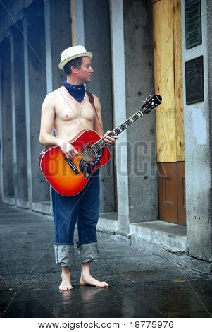 NEW ORLEANS - SEPT 2: An unidentified musician stands in an empty French Quarter of downtown New Orleans after Hurricane Gustav passed the area on September 2, 2008 in New Orleans.