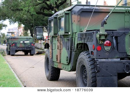 NEW ORLEANS - SEPT 1: Two National Guard humvees stop to inspect damage caused by Hurricane Gustav on September 1, 2008 in downtown New Orleans.