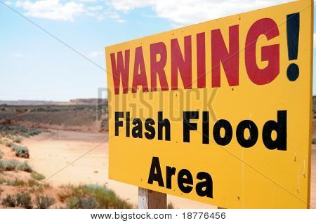 Warning sign for flash floods in a dry riverbed near Antelope Canyon in Page, Arizona