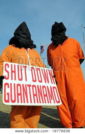 WASHINGTON - JAN 20: Hooded demonstrators demand the closing of Guantanamo during the inauguration of U.S. President Barack on January 20, 2009 in Washington.