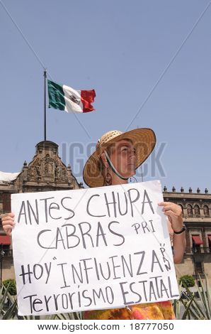 MEXICO CITY - APRIL 29: A protestor holds a sign that blames the Mexican government for the Swine Flu outside Palacio Nacional on April 29, 2009 in Mexico City.