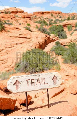 "Sign pointing to the trail on the way to the famous ""Delicate Arch"" in the Arches National Park near Moab, Utah, USA."