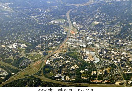Aerial view of Tysons Corner, McLean, the commercial center of Northern Virginia in Fairfax County, near Washington DC, from the north. The Beltway (I-495) running from lower left corner up.
