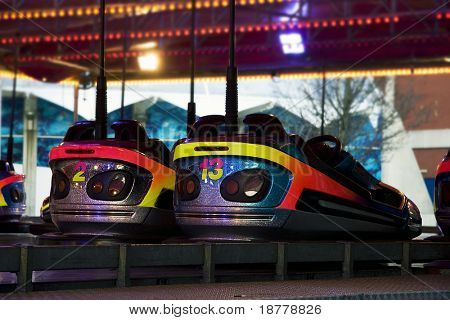 Two dodgem cars, rear view, at amusement park