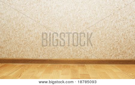 Wooden parquet floor and wallpaper on a wall