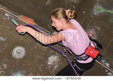 "RUSSIA, MOSCOW - DEC 12: Unidentified Girl climbing on a wall ""City youthful competitions on climbing sport Winter 2010"" December 12, 2010 in Moscow, Russia"