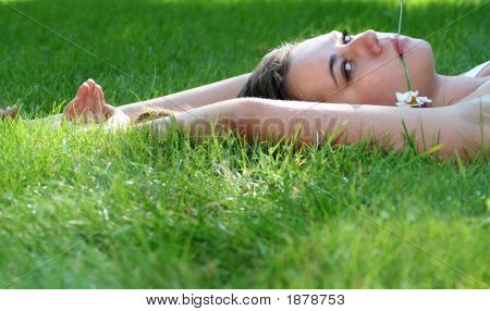 Woman Lying On A Lawn