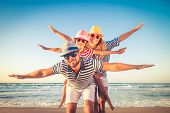 Happy Family Having Fun On Summer Vacation poster