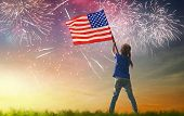 Patriotic holiday. Happy kid, cute little child girl with American flag. USA celebrate 4th of July. poster