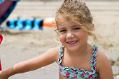 Happy Little Girl On The Beach poster