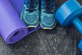 Yoga Mat, Sport Shoes, Dumbbells And Bottle Of Water On Blue Background. Concept Healthy Lifestyle, poster