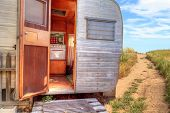Small Retro Caravan Camper Used As A Tiny House On Road Trips poster