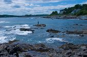 picture of striper  - Stiper Fisherman fishing rocky coast Southern Maine - JPG