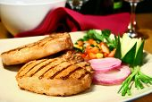 stock photo of pork chop  - grilled pork chops with sweet and spicy salsa - JPG