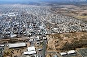 Aerial of border crossing and town of Agua Prieta, with Douglas, Arizona, below on the U.S. side of