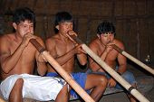 KAMAYURA VILLAGE, BRAZIL - MAY 18: Members of a threatened Indian tribe, the Kamayura, playing sacre