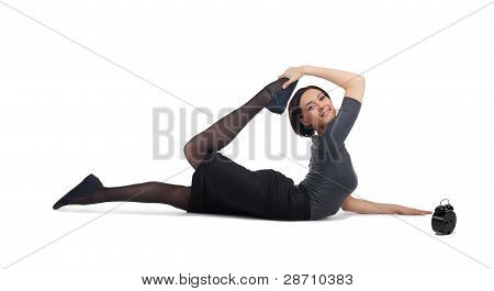 business woman lay in yoga pose with clock