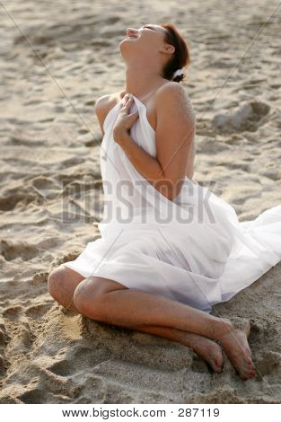 Woman In White Clothes On The Beach