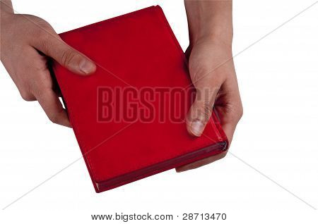 Closed note book in hand