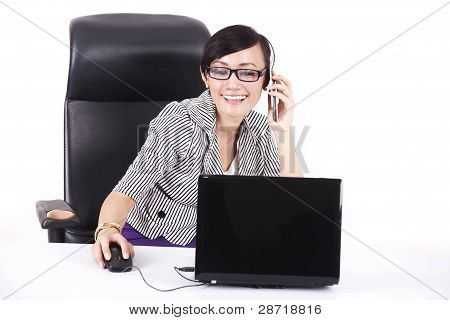 Smiling Businesswoman In Her Office