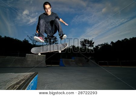 Skateboarder On A Flip Trick