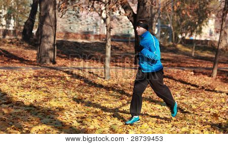Man Running In A Park