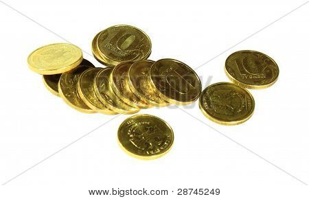 Coins (money) are scattered on a white background top view