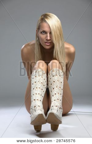 Sexy Blonde Model In Boots