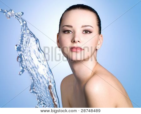 Girl With Clean Skin And Stream Of Water