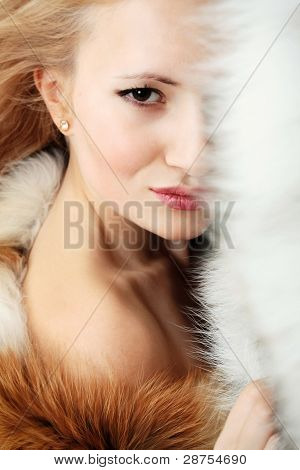 Young Attractive Girl With Fur Coat
