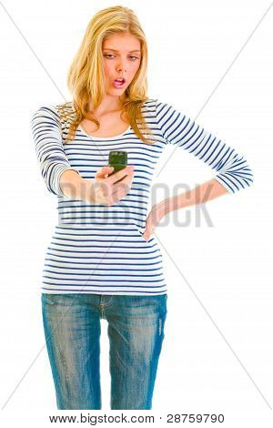 Surprised Teen Girl Looking On Mobile Phone
