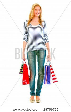 Full Length Portrait Of Teen Girl With Shopping Bags