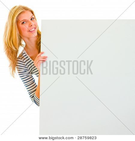 Portrait Of Teen Girl Holding Blank Billboard