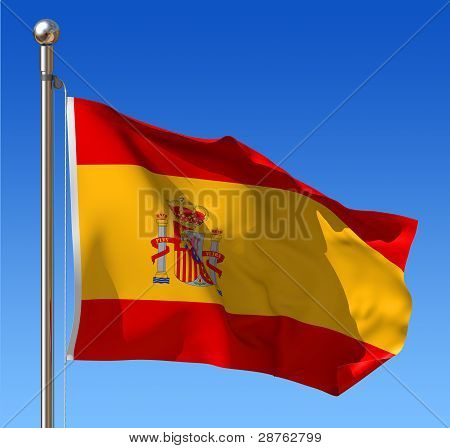 Flag of Spain against blue sky.