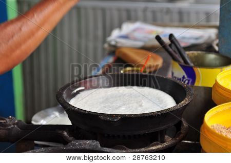 food seller prepare the pancake in the market