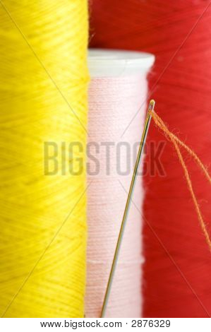 Threads In Yellow, Pink And Red Close Up.