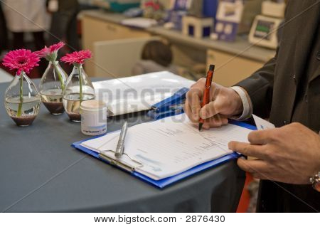 Signing A Contract On A Fair