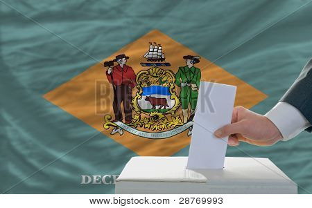 Man Voting On Elections In Front Of Flag Us State Flag Of Delaware