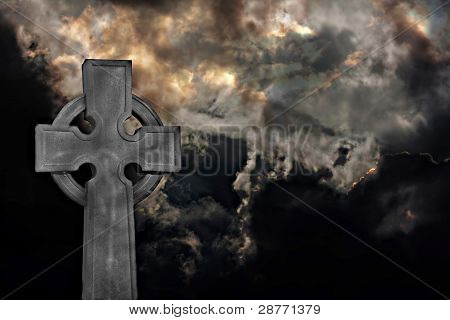 Graveyard Cross Against Storm Clouds