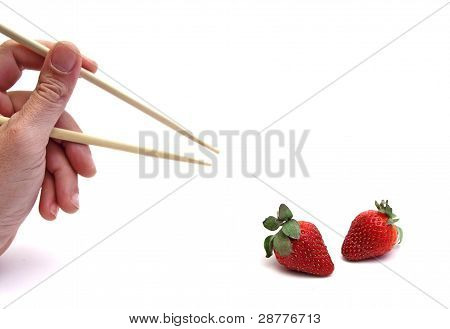 chopsticks and strawberry